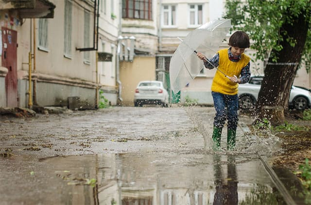Kid playing in the puddle